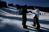 (077)  Kris Kloppe, left, and Trey Simmons, right, both of Denver, bump fists after a run on...