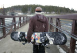 (084)  Steve Tomashek walks back to the parkin lot with his board on opening day at Winter Park...