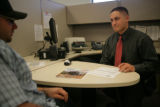 Clay Whittington (cq) a recruiter for Aerotek talks with Jon Berlin (cq) a potential applicant...