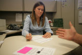 Nicole Norins (cq) a recruiter for Aerotek, looks over Charles Hill Jr.'s (cq) resume during a job...