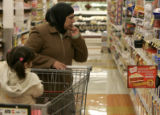 Soud Al Taai looks at the prices in King Soopers and tries to decide what would be the best option...