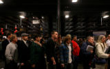 (PG963) Unemployed workers stand in line to talk with companies at a job fair in Longmont, Colo.,...