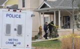 Investigators from the Colorado Springs Police Dept. enter the residence of Edward Fitzgerald on...