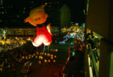 Dennis the Menace crosses over the 16th street mall on Tremont street during the Parade of Lights...