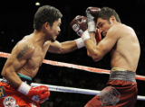 NVTG116 - WBC lightweight champion Manny Pacquiao throws a left to the head of Oscar De La Hoya...