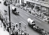 Aug 12, 1958 Covered wagons on 16th street during the Centennial Fiesta to celebrate Colorado's...