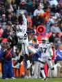 (1206) Jay Cutler overthrows Eddie Royal who is defended by Hiram Eugene in the third quarter of...