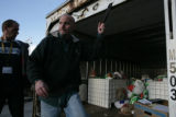 Kevin Jones (cq) shuts the door on a truck holding turkeys for The Denver Rescue Mission at 1130...