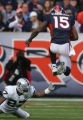 (683) Brandon Marshall jumps over Rashad Baker in the first quarter of the Denver Broncos against...