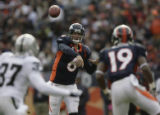 JPM297 Denver Broncos Jay Cutler passes to passes the ball to Eddie Royal (19) as Oakland Raiders...