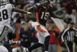 JPM310 Denver Broncos Brandon Marshall (15) carries the ball away from  Oakland Raiders Gibril...
