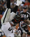 JPM521 Denver Broncos Jaime Winborn runs toward an upended Oakland Raiders Justin Fargas (25) in...