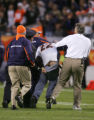 (1020) A fan is escorted off the field in the fourth quarter of the Denver Broncos against the...