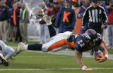 (1173) Peyton Hillis leaps into the endzone for a touchdown in the third quarter of the Denver...
