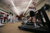 Steve Kovach works out on the treadmill at the Reunion Recreation Center, in Commerce City, Colo....