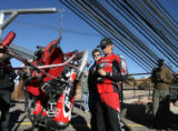 Go Fast Jet Pack Pilot, Eric Scott, gets his 135 pound jet pack ready, to do a PRACTICE LIFT OFF,...