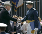 United States Vice President Dick Cheney, cq, left, shakes hands with Cadet Colonel Nicholas...