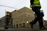 A construction worker leaves on Friday, December 5, 2008 after working at the new Justice Center...