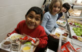 Jose Ledezma, goes through the lunch line with 2nd graders at East Elementary School in...