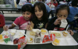 2nd grade best friends L-R Bridget Pinedo, Leslie Lopez and Laura Zamora enjoy their lunch break...