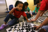 MJM085   Jasmine Jimenez (cq), 6, left, plays chess with her sister, Natalie Jimenez (cq), 7,...