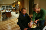 MJM413  Tracy Keil serves dinner to her husband, Matt Keil at their Parker, Colo. home on Monday...