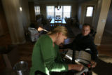 MJM043  Tracy Keil works on assembling a deep fry cooker, as her husband, Matt Keil helps by...
