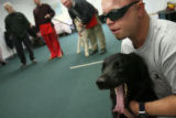 MJM133  Disabled Iraq veteran, Joel Hunt (cq) helps to train future service dog, Tonka Tuesday...