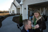MJM221  Tracy Keil gives her husband, Matt Keil a drink of wine outside their Parker, Colo. home...