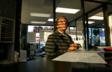 0107  Tree King, a sales consultant at the Grand Pontiac, Buick, GMC, Kia  dealership on 104th...