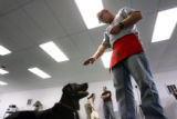 MJM236   Disabled Iraq veteran, Joel Hunt (cq) helps to train future service dog, Tonka Tuesday...