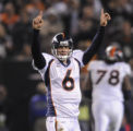 ({SEQN) } Quarterback Jay Cutler raises his arms after connecting with Daniel Graham on a 28-yard...