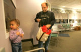 0153 Ron Perko cares for his daughter Grace while visiting  a doctors office in Littleton Colo.,...