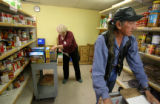 Volunteers Sue Hoogstrate (cq), left and John Thunderhawk (cq) fill clients food orders, ...