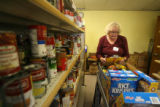 Volunteer Sue Hoogstrate (cq) fills a clients food order,  Wednesday morning, November 12, 2008,...