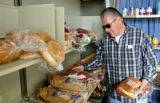 Roy Salas (cq) picks some bread, Wednesday morning, November 12, 2008, Metro CareRing, 1100 E....