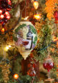 A Tuscan-style Christmas ornament by Paul Brent hangs on a tree in the home of Diane Muno, the...