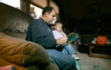 0051 Ron Perko cares for his daughter Grace while he continues to search for work after being laid...