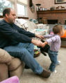 0029 Ron Perko cares for his daughter Grace while he continues to search for work after being laid...