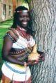 "0122 COPY PHOTOGRAPH: Micklina Peter, one of the ""Lost Girls of Sudan,""  wears a..."