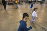 (0172) Centered, John-John Prieto, 4, runs with Larenya Chapman, 4,  and his his brother Leandro...
