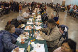 (0300) Folks eat a Thanksgiving dinner provided by the Salvation Army Thursday, Nov. 27, 2008, at...