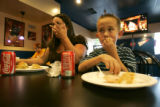 0182 Monika Fernandez, CQ, 34, and her son Damian, Fernandez, 7, enjoy a free meal at Philly's...