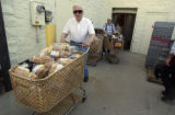 Jefferson Award winner Bill Hammond (cq Bill Hammond) 80, pushes a grocery cart containing donated...