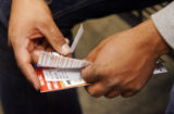 Abdon Garcia, 23, of Mexico City, holds his bus tickets for his southbound trip to Mexico. He...