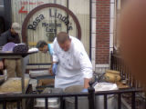 Chef Jason Sweetman volunteers outside Rosa Linda's Mexican Cafe to help prepare at least 3,000...