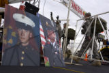 Two photos of Sgt. Jon Stiles sit near the finish line as National Guardsmen finish the 5th annual...