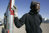 Dwight Ivory picks up trash at a day labor job Friday November 28. 2008. He was grateful to have a...
