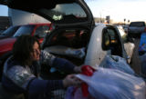 MJM292   Mary Erwin (cq) of Lakewood, Colo. loads her purchases in her PT Cruiser outside Wal-Mart...