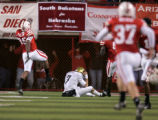 (1160) Cody Hawkins sits on the urf as Nebraska celebrates after he threw an interception for a...